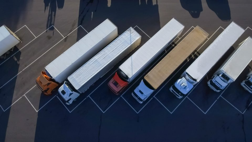 line of semi-trucks from above